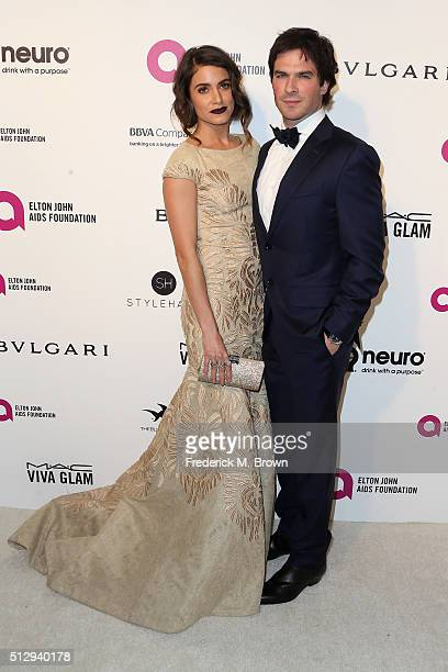 Actors Nikki Reed and Ian Somerhalder attend the 24th Annual Elton John AIDS Foundation's Oscar Viewing Party on February 28 2016 in West Hollywood...