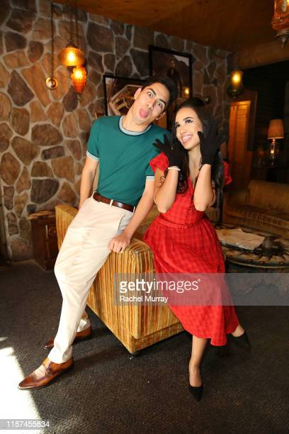 Actors Niko Guardado and Emily Tosta attend the Once Upon A Time In Hollywood 60's themed party on July 23 2019 in Los Angeles California