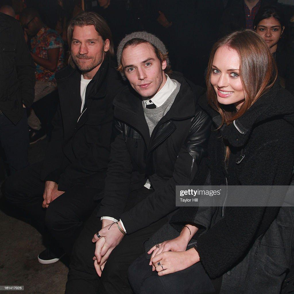 Actors Nikolaj Coster-Waldau, Sam Claflin, and Laura Haddock attend the Y-3 Fall 2013 Mercedes-Benz Fashion Show at 80 Essex Street on February 10, 2013 in New York City.
