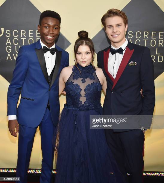 Actors Niles Fitch Hannah Zeile and Logan Shroyer attend the 24th Annual Screen Actors Guild Awards at The Shrine Auditorium on January 21 2018 in...