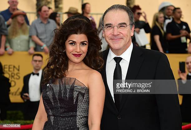 Actors Nimrat Kaur and Mandy Patinkin arrive for the 21st Annual Screen Actors Guild Awards January 25 2015 at the Shrine Auditorium in Los Angeles...