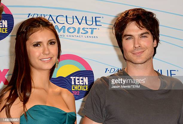 Actors Nina Dobrev and Ian Somerhalder winners of Choice Fantasy/SciFi Show award pose in the press room during the 2012 Teen Choice Awards at Gibson...