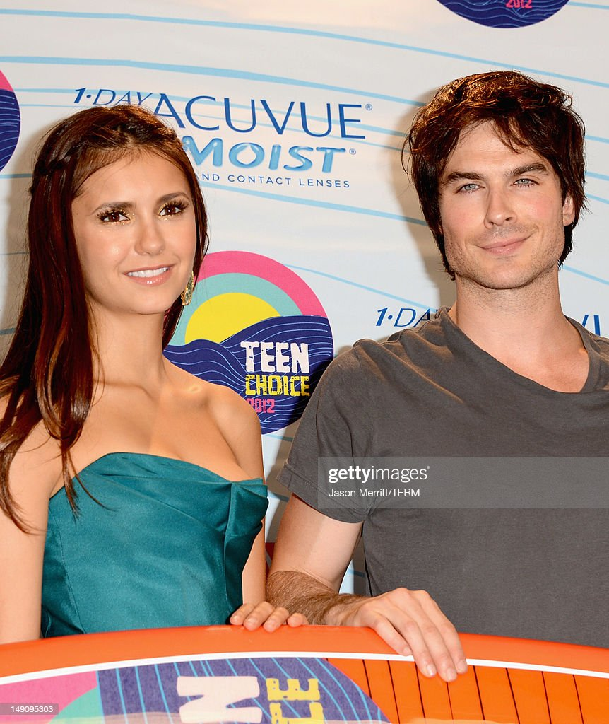 Actors Nina Dobrev and Ian Somerhalder, winners of Choice Fantasy/Sci-Fi Show award, pose in the press room during the 2012 Teen Choice Awards at Gibson Amphitheatre on July 22, 2012 in Universal City, California.