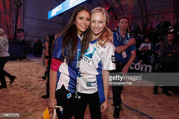 Actors Nina Dobrev of Team Palladia HDand Candice Accola of Team Spike TV attend DIRECTV's Sixth Annual Celebrity Beach Bowl Game at Victory Field on...