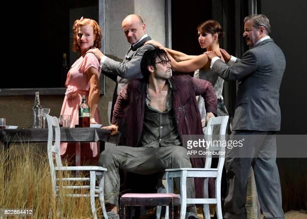 Actors Nina Petri Oliver Stokowski Max Simonischek Andrea Wenzl Roland Koch perform in the rehearsal of Harold Pinter's 'Die Geburtstagsfeier' in...