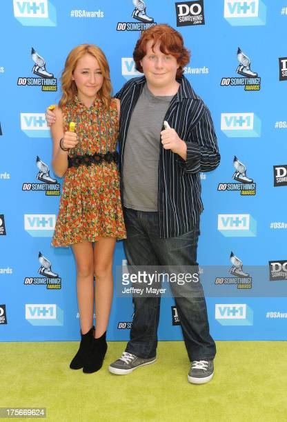 Actors Noah Cyrus and Tucker Albrizzi arrive at the DoSomethingorg and VH1's 2013 Do Something Awards at Avalon on July 31 2013 in Hollywood...