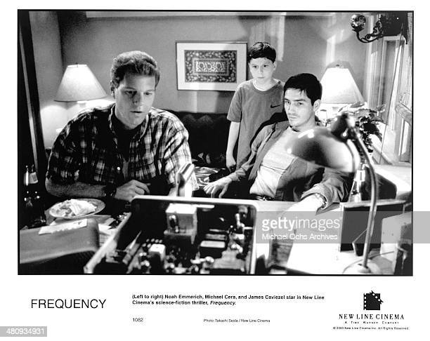 Actors Noah Emmerich Michael Cera and Jim Caviezel in a scene from the New Line Cinema movie ' Frequency ' circa 2000