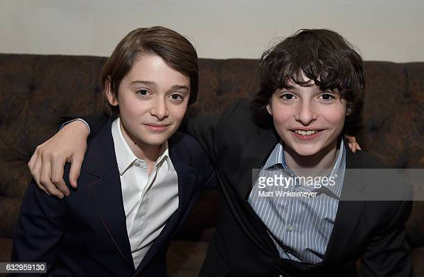 Actors Noah Schnapp and Finn Wolfhard attend the Entertainment Weekly Celebration of SAG Award Nominees sponsored by Maybelline New York at Chateau...