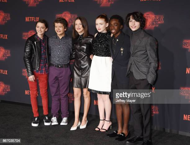 Actors Noah Schnapp Gaten Matarazzo Millie Bobby Brown Sadie Sink Caleb McLaughlin and Finn Wolfhard arrive at the Premiere Of Netflix's 'Stranger...