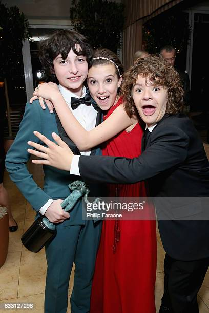 Actors Noah Schnapp Millie Bobby Brown and Gaten Matarazzo attend The Weinstein Company Netflix's 2017 SAG After Party in partnership with Absolut...