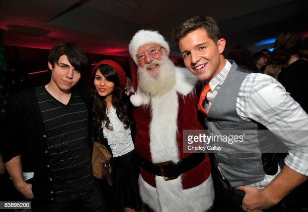 Actors Nolan Gerard Funk Victoria Justice and Simon Curtis attend the after party for Merry Christmas Drake Josh at the Westside Pavillion on...