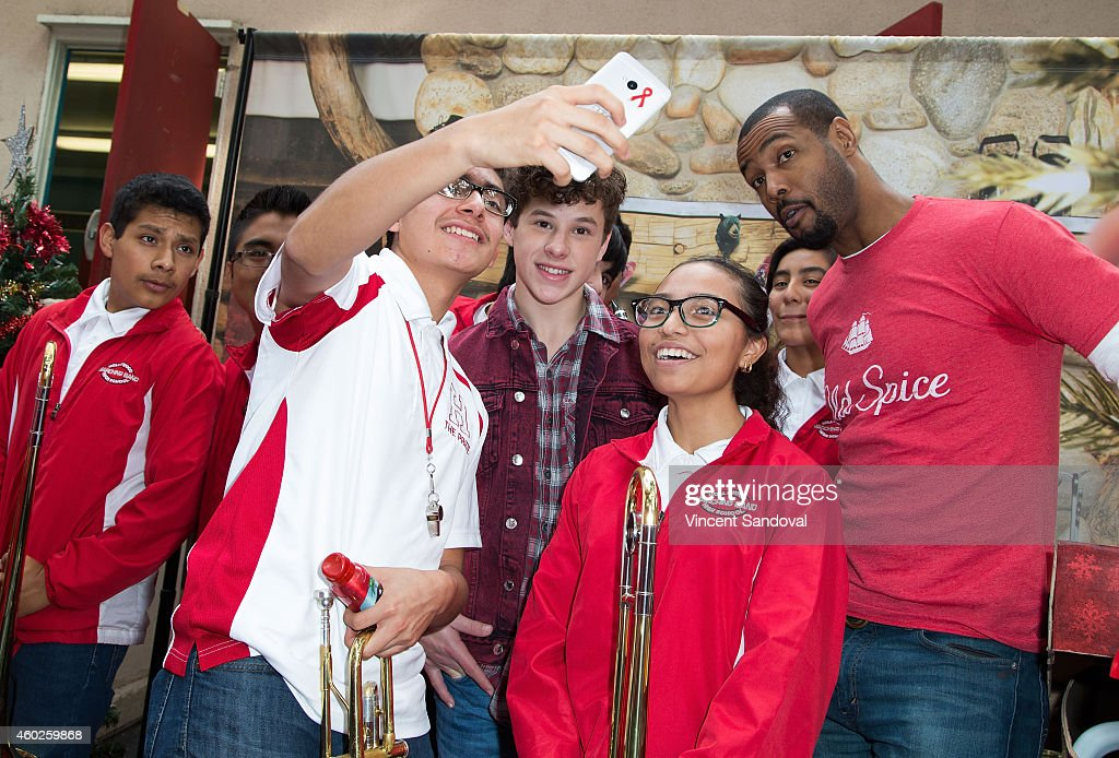 Actors Nolan Gould (L) and Isaiah Mustafa attend the Inaugural Old Spice Holispray Holiday Toy Donation and Exchange Benefit for Second Chance Toys at Hollywood High School on December 10, 2014 in Los Angeles, California.