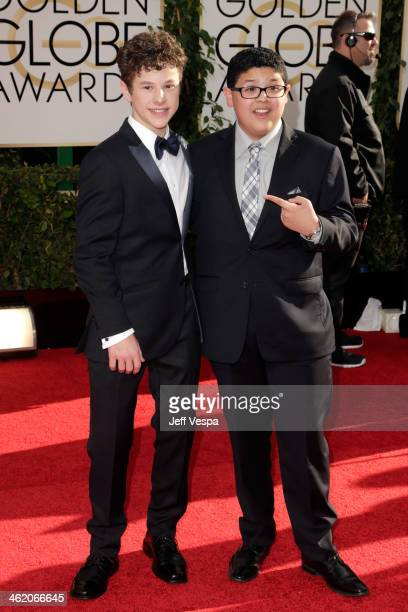 Actors Nolan Gould and Rico Rodriguez attend the 71st Annual Golden Globe Awards held at The Beverly Hilton Hotel on January 12 2014 in Beverly Hills...