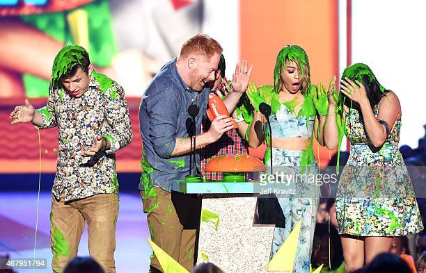 Actors Nolan Gould Jesse Tyler Ferguson Rico Rodriguez Sarah Hyland and Ariel Winter get slimed onstage during Nickelodeon's 28th Annual Kids' Choice...