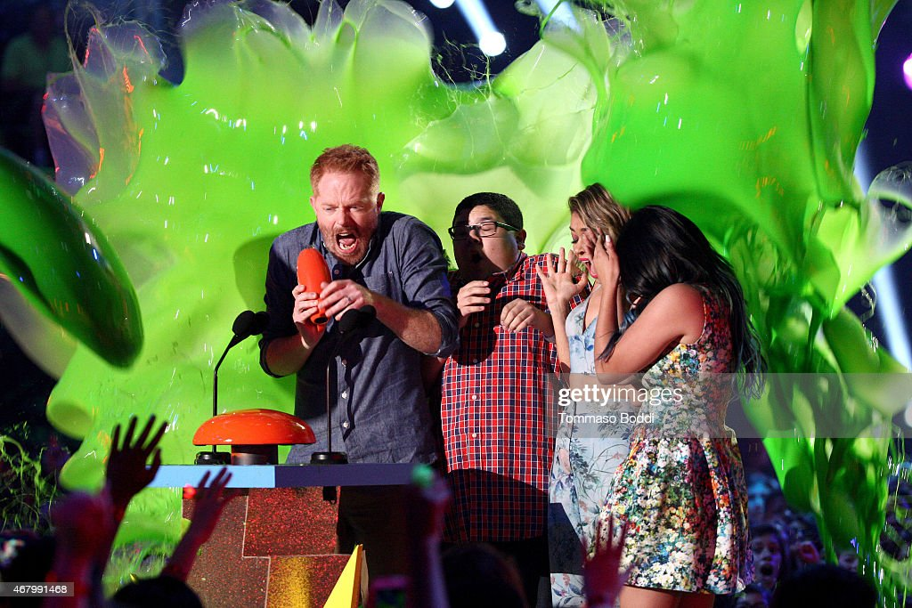 Actors Nolan Gould, Jesse Tyler Ferguson, Rico Rodriguez, Sarah Hyland and Ariel Winter get slimed as they accept the award for Favorite Family TV Show for 'Modern Family' onstage during the Nickelodeon's 28th Annual Kids' Choice Awards held at The Forum on March 28, 2015 in Inglewood, California.