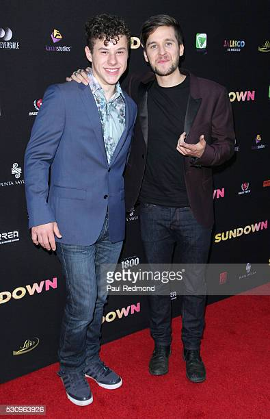Actors Nolan Gouls and Devon Werkheiser arrive at the Premiere of Pantelion Films' 'Sundown' at ArcLight Hollywood on May 11 2016 in Hollywood...