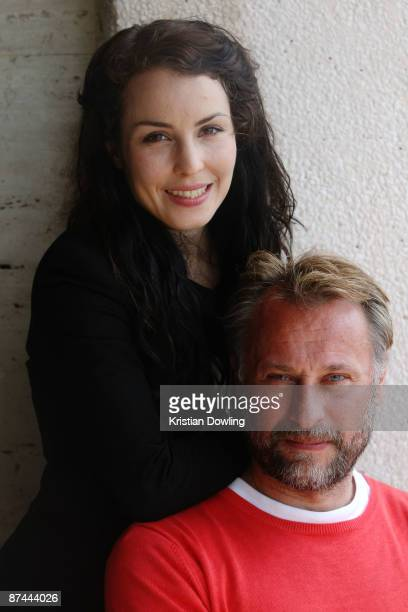 Actors Noomi Rapace and Michael Nyqvist attend 'The Girl With The Dragon Tattoo' photocall held at the Palais Des Festivals during the 62nd...