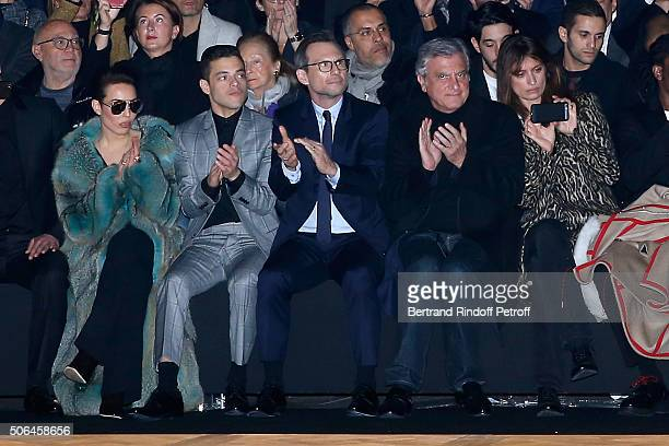 Actors Noomi Rapace Rami Malek Christian Slater CEO Dior Sidney Toledano and Caroline de Maigret attend the Dior Homme Menswear Fall/Winter 20162017...
