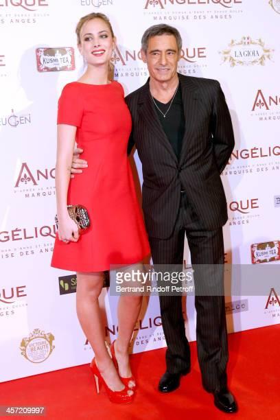Actors Nora Arnezeder and Gerard Lanvin attend the 'Angelique' Paris movie premiere at Cinema Gaumont Capucine on December 16 2013 in Paris France