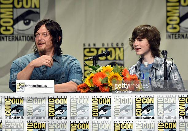 Actors Norman Reedus and Chandler Riggs attend AMC's 'The Walking Dead' panel during ComicCon International 2014 at San Diego Convention Center on...