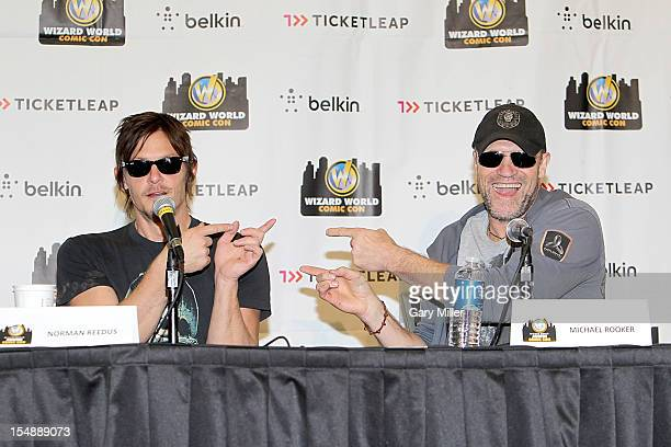 Actors Norman Reedus and Michael Rooker speak during a QA on The Walking Dead during the Wizard World Austin Comic Con at the Austin Convention...