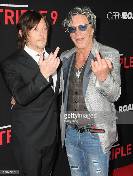 Actors Norman Reedus and Mickey Rourke attend the Premiere of Open Road's 'Triple 9' at Regal Cinemas LA Live on February 16 2016 in Los Angeles...