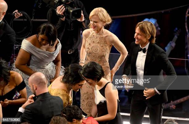 Actors Octavia Spencer and Nicole Kidman and musician Keith Urban in the audience during the 89th Annual Academy Awards at Hollywood Highland Center...