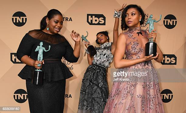 Actors Octavia Spencer Janelle Monae and Taraji P Henson winners of the Outstanding Cast in a Motion Picture award for 'Hidden Figures' pose in the...