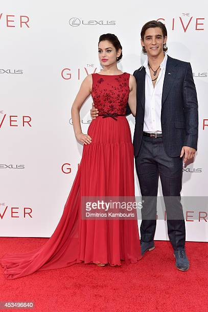 Actors Odeya Rush and Brenton Thwaites attend The Giver premiere at Ziegfeld Theater on August 11 2014 in New York City