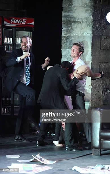 Actors of La ReSentida Chilean theatre company perform during a scene from 'La Imaginacion Del Futuro' directed by Marco Layera on July 16 2014 in...
