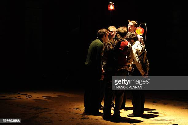 Actors of 'Raoul Collectif' perform during a rehearsal of the play 'Rumeur et petits jours' on July 16 2016 at the 'Cloitre des Carmes' in Avignon...