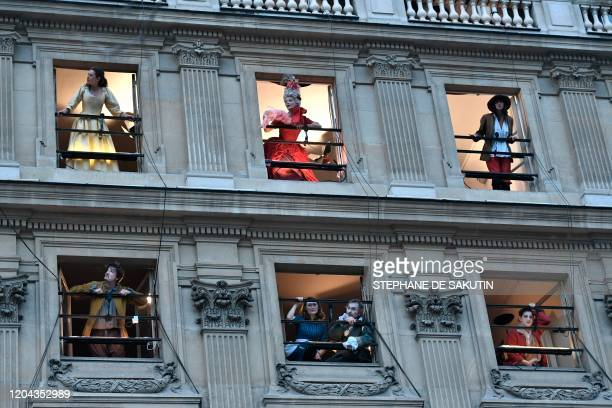 Actors of the Comedie Francaise with costumes perform on the balconies of the Comedie Francaise to protest against the pension reform on March 1 2020...