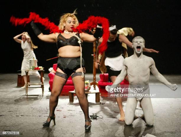 Actors of the Compagnia Pippo Delbono perform a scene of 'Guerra' by Italian director Pippo Delbono 14 July 2002 in Avignonduring the 56th Theater...