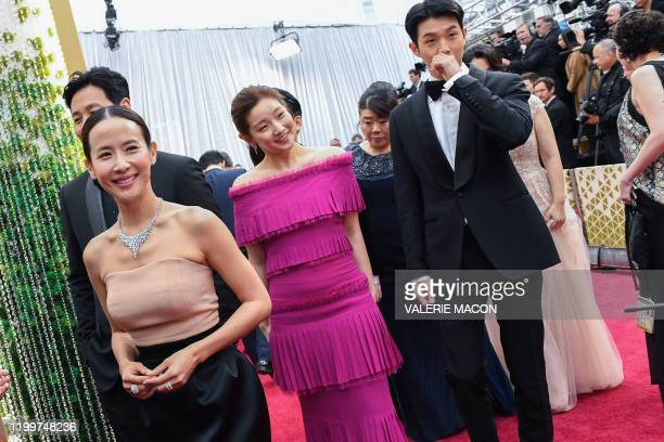 Actors of the Korean movie Parasite Yeojeong Jo So Dam Park and WooSik Choi arrive for the 92nd Oscars at the Dolby Theatre in Hollywood California...