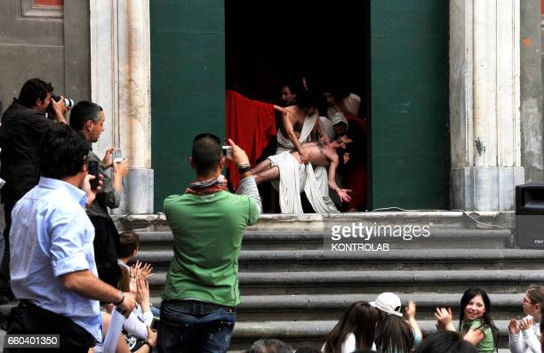Actors of the 'Ludovica Carambelli Theater' company perform as they form a representation of Caravaggio's during the 'Tableaux Vivants' The theather...