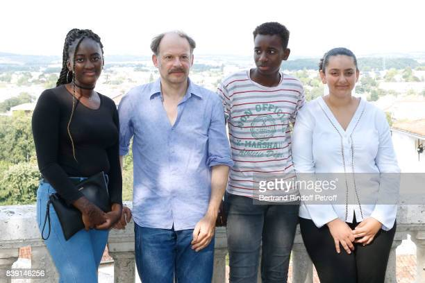 Actors of the movie 'Les grands esprits' Denis Podalydes Salon Fanta Abdoulaye Diallo and Mona Magdy Fahim attend the 10th Angouleme FrenchSpeaking...