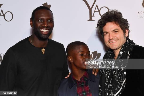 Actors of the movie Omar Sy Lionel LouisBasse and composer of the movie soundtrack Matthieu Chedid aka M attend 'Yao' Paris Premiere at Le Grand Rex...