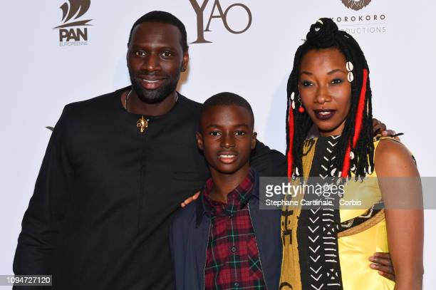 Actors of the movie Omar Sy Lionel LouisBasse and Fatoumata Diawara attend 'Yao' Paris Premiere at Le Grand Rex on January 15 2019 in Paris France