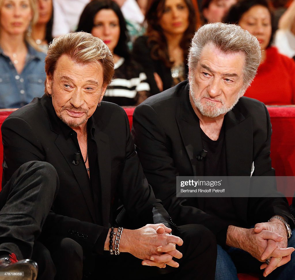 Actors of the movie 'Salaud, on t'aime' Johnny Hallyday and Eddy Mitchell attend the 'Vivement Dimanche' French TV show at Pavillon Gabriel on March 14, 2014 in Paris, France.