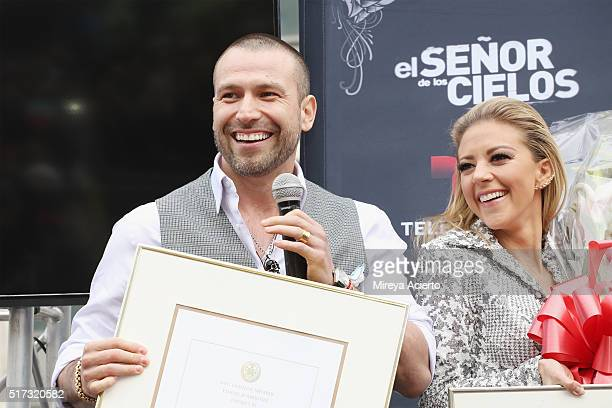 Actors of the Telemundo telenovela 'Senor de los dos Cielos' Rafael Amaya and Fernanda Castillo receive an award by New York City Council member...