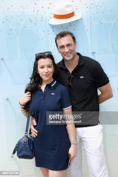 Actors of the Theater Play Le Fusible Gaelle Gauthier and Arnaud Gidoin all dressed in Lacoste attend the 2017 French Tennis Open Day Two at Roland...