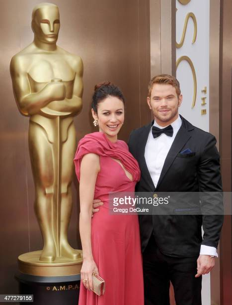 Actors Olga Kurylenko and Kellan Lutz arrive at the 86th Annual Academy Awards at Hollywood Highland Center on March 2 2014 in Hollywood California