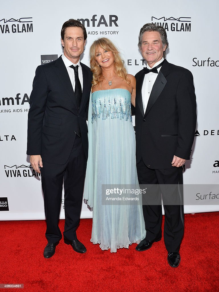 Actors Oliver Hudson, Goldie Hawn and Kurt Russell arrive at amfAR The Foundation for AIDS 4th Annual Inspiration Gala at Milk Studios on December 12, 2013 in Hollywood, California.