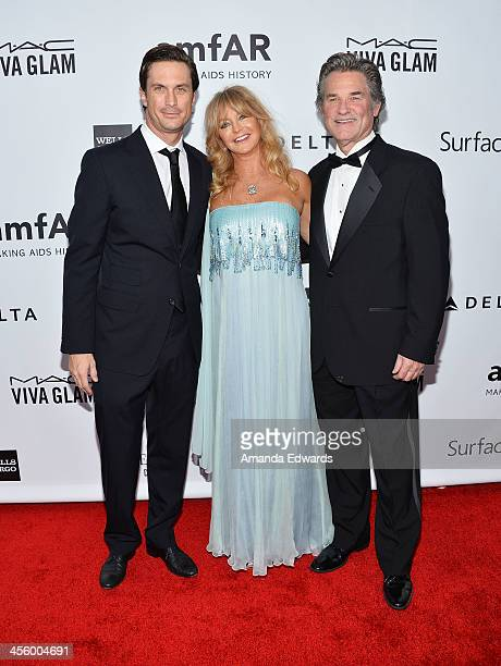 Actors Oliver Hudson Goldie Hawn and Kurt Russell arrive at amfAR The Foundation for AIDS 4th Annual Inspiration Gala at Milk Studios on December 12...