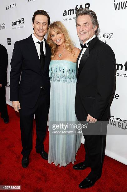 Actors Oliver Hudson Goldie Hawn and Kurt Russell attend the 2013 amfAR Inspiration Gala Los Angeles presented by MAC Viva Glam at Milk Studios on...