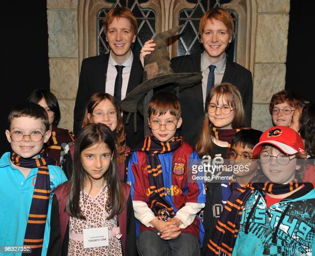 Actors Oliver Phelps and James Phelps attend Harry Potter The Exhibition at the Ontario Science Centre on April 8 2010 in North York Canada