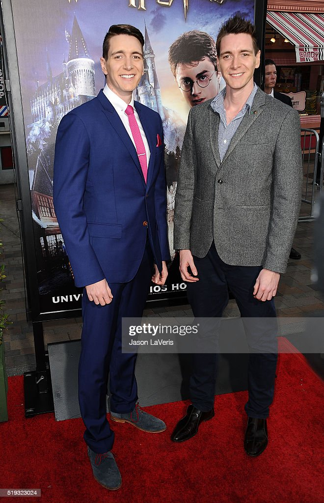 Actors Oliver Phelps and James Phelps attend the opening of 'The Wizarding World of Harry Potter' at Universal Studios Hollywood on April 5, 2016 in Universal City, California.