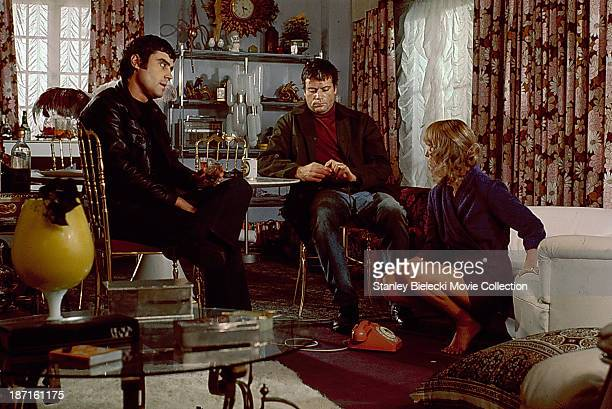 Actors Oliver Reed Ian McShane and Jill Townsend in a scene from the movie 'Sitting Target' 1972