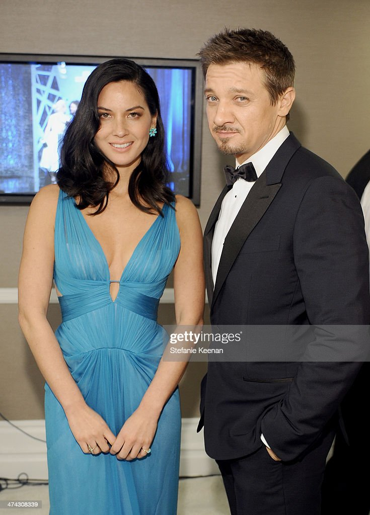 Actors Olivia Munn (L) and Jeremy Renner attend the 16th Costume Designers Guild Awards with presenting sponsor Lacoste at The Beverly Hilton Hotel on February 22, 2014 in Beverly Hills, California.
