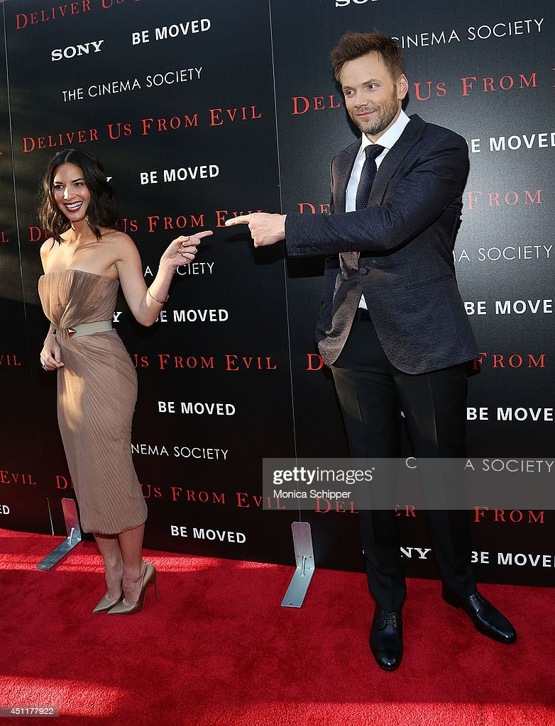 Actors Olivia Munn (L) and Joel McHale attend the 'Deliver Us From Evil' screening hosted by Screen Gems & Jerry Bruckheimer Films with The Cinema Society at SVA Theater on June 24, 2014 in New York City.